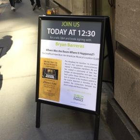 Sign on sidewalk outside museum